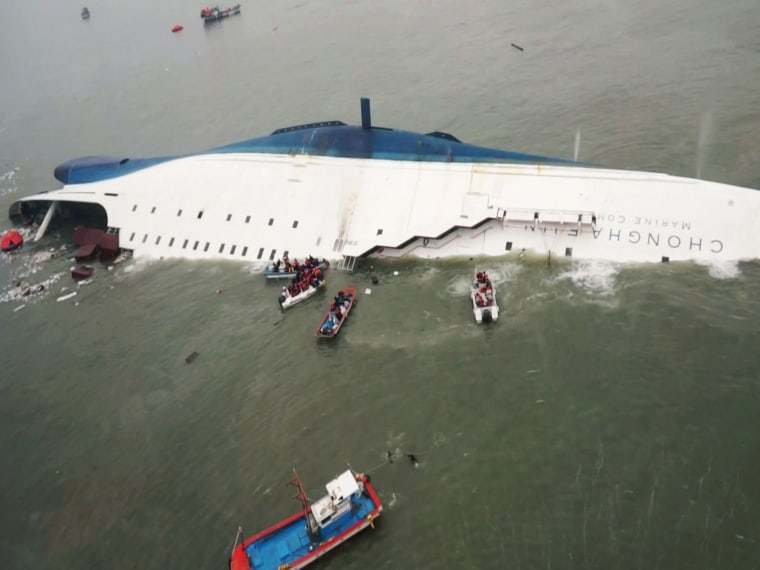 """Image: South Korean ferry """"Sewol"""" is seen sinking in the sea off Jindo"""