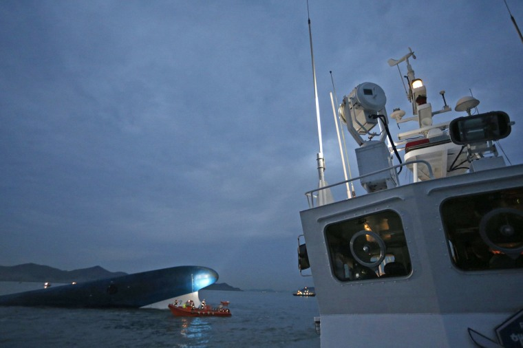 """Image: South Korean ferry """"Sewol"""" is seen sinking at the sea off Jindo"""