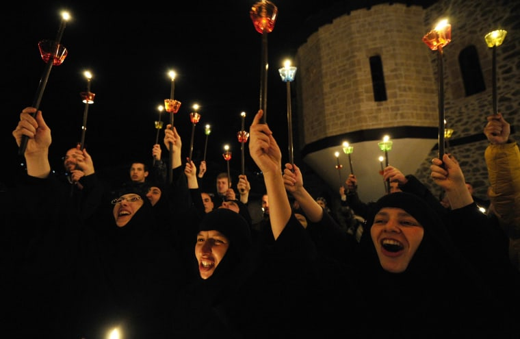 Image: Orthodox Christian nuns sing during a holy Easter service at the St. John the Baptist Monastery near Mavrovo