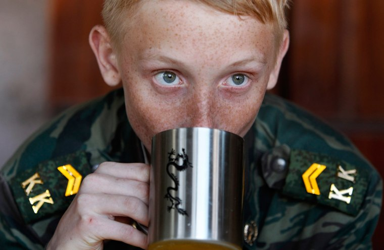 Image: A student from the General Yermolov Cadet School has a drink during a two-day field exercise near the village of Sengileyevskoye
