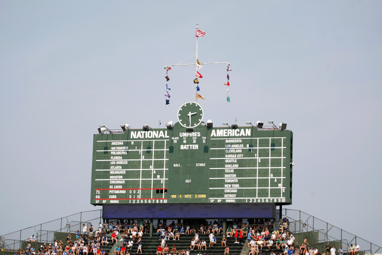 CHICAGO, IL - SEPTEMBER 2: A general view of the manually operated scoreboard at Wrigley Field during the game between the Pittsburgh Pirates against the Chicago Cubs at Wrigley Field on September 2, 2011 in Chicago, Illinois. The Pirates defeated the Cubs 3-1. (AP Photo/Scott Boehm)