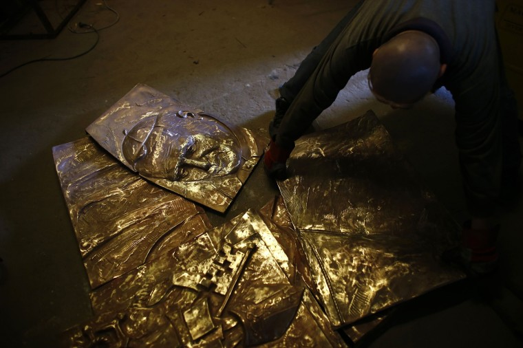 Image: A bas-relief of the late Pope John Paul II, made of bronze, is being worked on in Krakow
