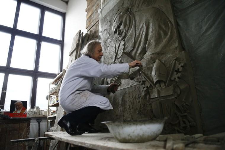 Image: Sculptor Czeslaw Dzwigaj works on bas-relief of the late Pope John Paul II in his atelier near Krakow