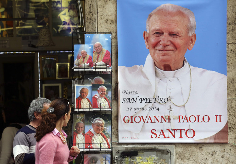 Image: Pictures depicting the late Pope John Paul II are displayed in a shop in Rome