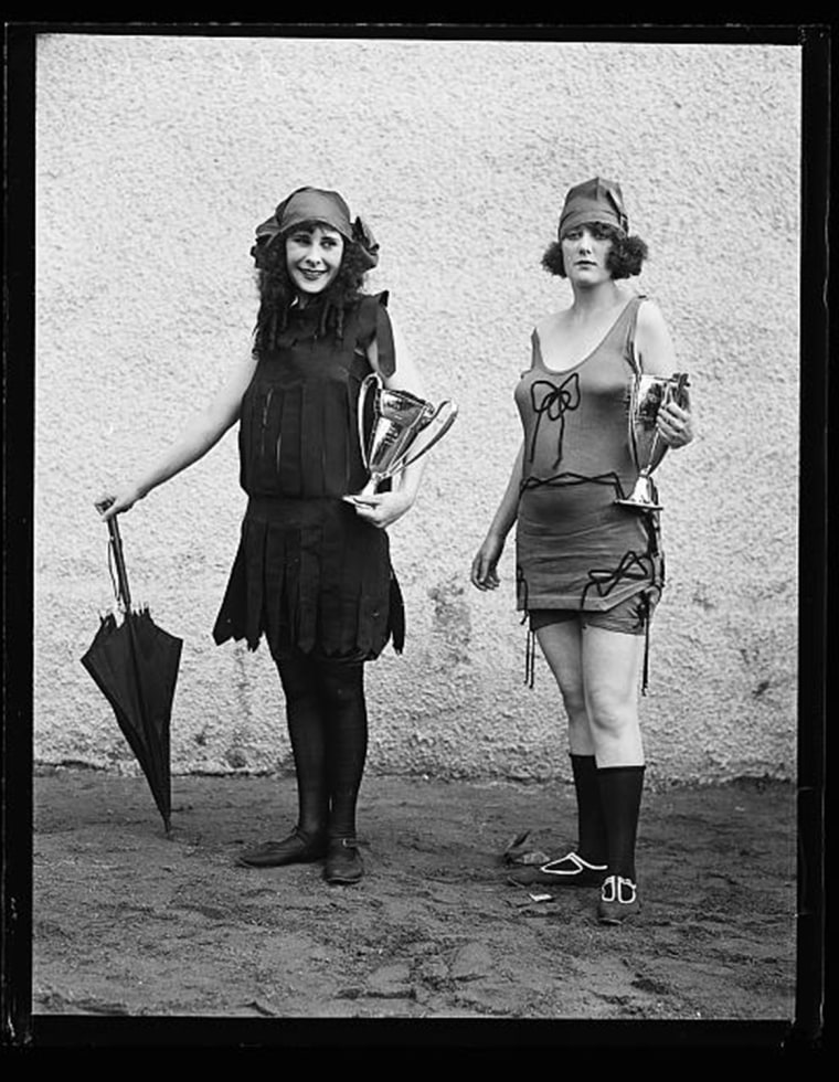 Women in bathing suit with prize cups 1922