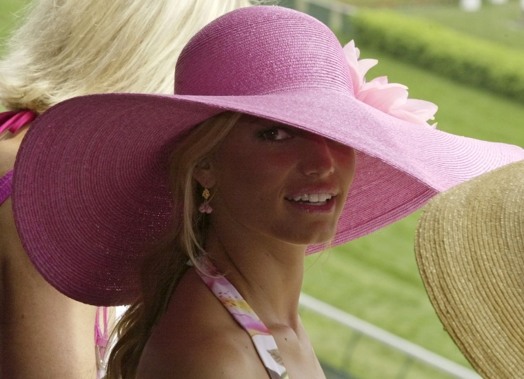 Singer Jessica Simpson wears a colorful hat during Kentucky Derby day festivities at Churchill Downs, Saturday, May 1, 2004, in Louisville, Ky. (AP Photo/Darron Cummings)