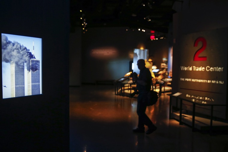 Image: Video images are displayed inside the National September 11 Memorial & Museum during a press preview in New York