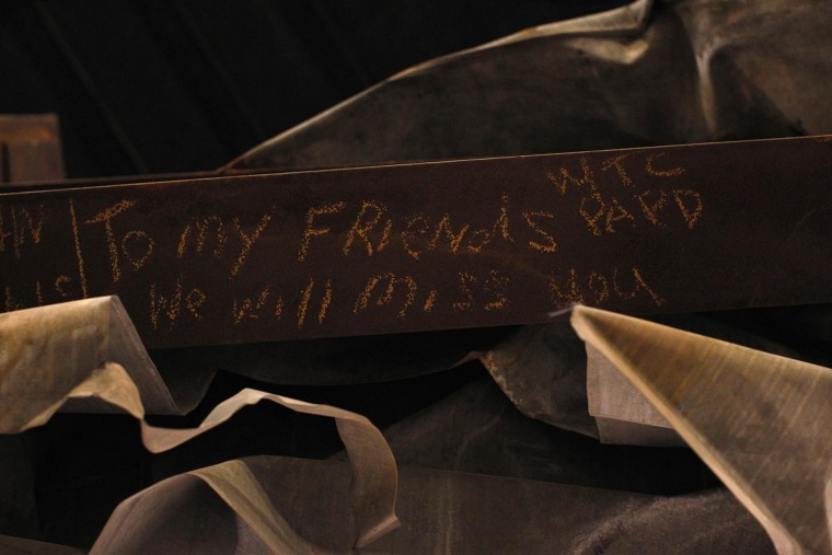 """Image: A message is seen on the bottom of the """"Cross"""" which is displayed in The National September 11 Memorial and Museum under construction at the World Trade Center site in New York"""