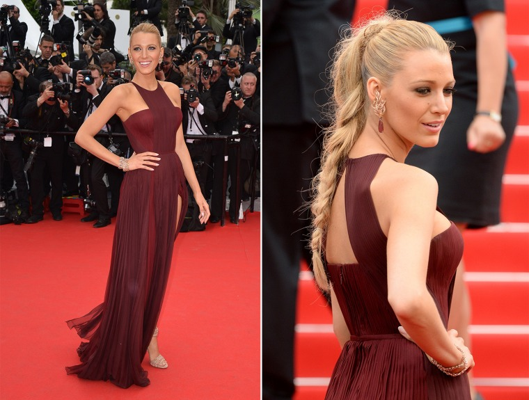 """US actress Blake Lively poses as she arrives for the Opening ceremony of the 67th edition of the Cannes Film Festival in Cannes, southern France, on May 14, 2014. AFP PHOTO / ALBERTO PIZZOLIALBERTO PIZZOLI/AFP/Getty Images CANNES, FRANCE - MAY 14:  Actress Blake Lively attends the Opening ceremony and the """"Grace of Monaco"""" Premiere during the 67th Annual Cannes Film Festival on May 14, 2014 in Cannes, France.  (Photo by Dave J Hogan/Getty Images)"""