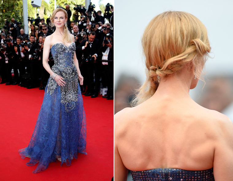 """Cast member Nicole Kidman poses on the red carpet as she arrives for the opening ceremony and the screening of the film """"Grace of Monaco"""" (Grace de Monaco) out of competition during the 67th Cannes Film Festival in Cannes May 14, 2014. The festival will run from May 14 to 25.          REUTERS/Eric Gaillard (FRANCE  - Tags: ENTERTAINMENT)  CANNES, FRANCE - MAY 14:  Actress Nicole Kidman attends the Opening Ceremony and the """"Grace of Monaco"""" premiere during the 67th Annual Cannes Film Festival on May 14, 2014 in Cannes, France.  (Photo by Pascal Le Segretain/Getty Images)"""