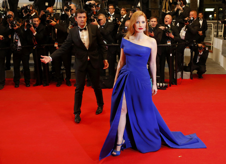 """Image: Cast member Jessica Chastain poses on the red carpet as she arrives for the screening of the film """"The Disappearance of Eleanor Rigby"""" at the 67th Cannes Film Festival in Cannes"""