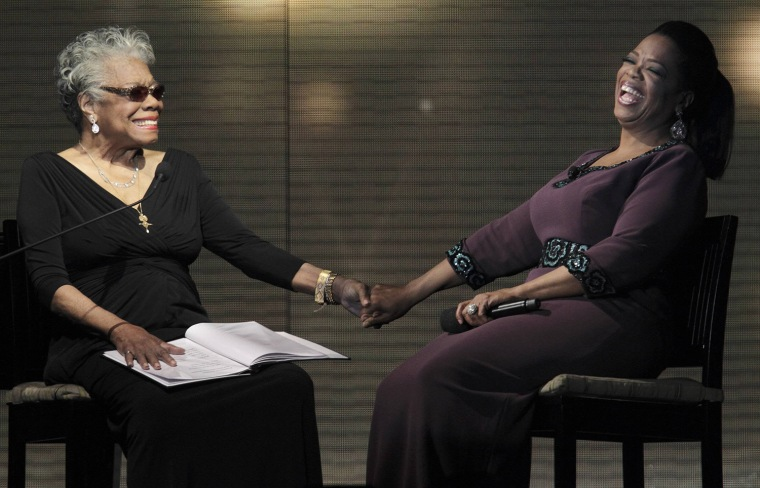 Image: File photo of Oprah Winfrey with poet Maya Angelou during the taping of Oprah's Surprise Spectacular in Chicago