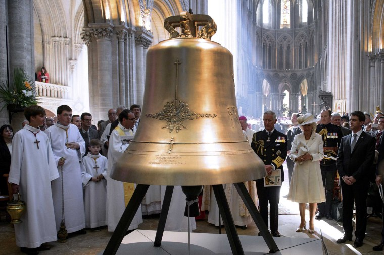 Image: Britain's Prince Charles his wife Camilla the Duchess of Cornwall and French Prime Minister Valls attend a bell-naming ceremony during D-Day commemoration ceremony in Bayeux Cathedral