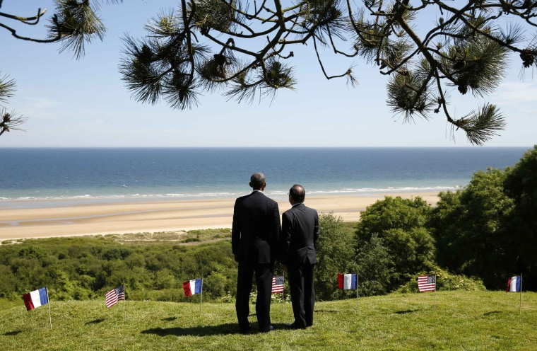 Image: Obama and Hollande look out over Omaha Beach in Colleville-sur-Mer