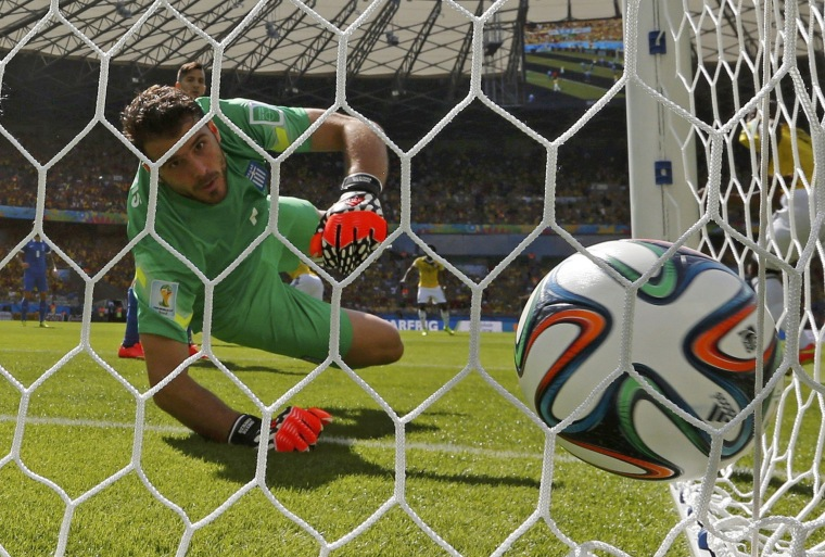 Image: Greece's Karnezis watches as the ball goes into the net in a goal scored by Colombia's Armero during their 2014 World Cup Group C soccer match at the Mineirao stadium in Belo Horizonte