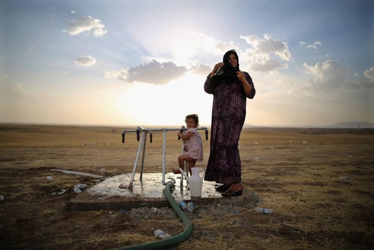 Image: *** BESTPIX *** Refugees Flee Iraq After Recent Insugent Attacks