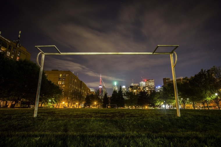 Image: The city skyline is seen through a soccer goalpost in Toronto