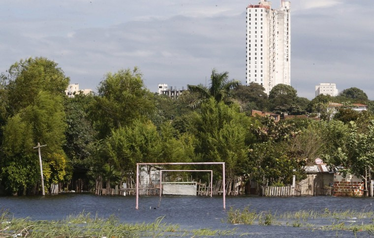 Image: Goalposts stand in a soccer field flooded by the waters of the Paraguay River in Asuncion