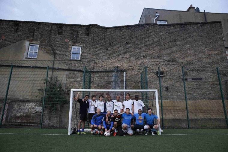 "Image: Players for ""The Tuesdays"" pose in a soccer goalpost at a training ground in Balham, south London"