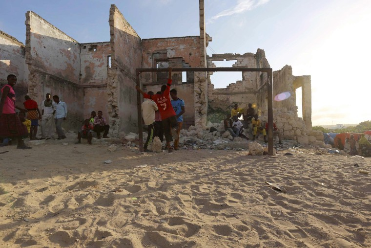 Image: Boys stand next to a soccer goalpost in Sayidka in southern Mogadishu