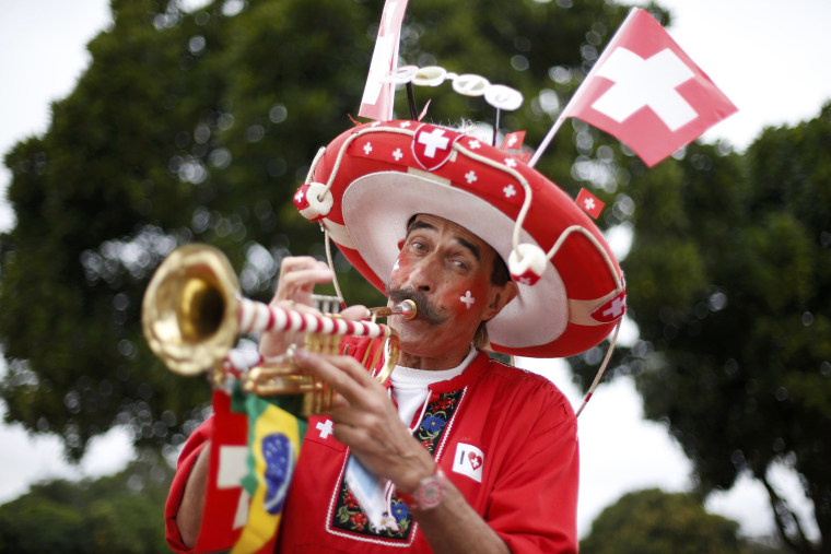 Image: A Switzerland soccer fan arrives at the National stadium to watch his team play Ecuador in a 2014 World Cup match in Brasilia