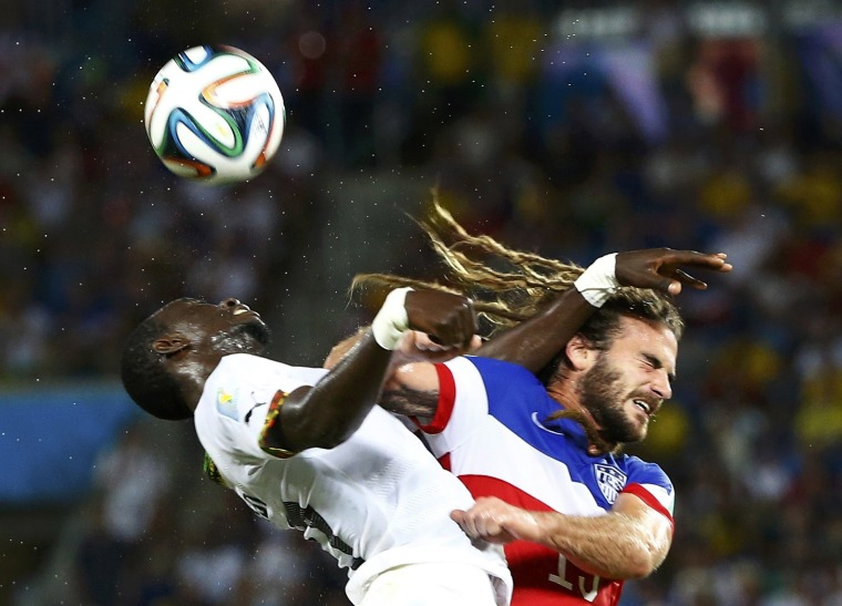 Image: Beckerman of the U.S. is fouled by Ghana's Rabiu during their 2014 World Cup Group G soccer match at the Dunas arena in Natal