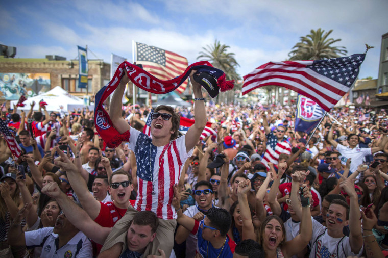 Image: Fans cheer after the U.S. scored a second goal during the 2014 Brazil World Cup Group G soccer match between Ghana and the U.S. at a viewing party in Hermosa Beach