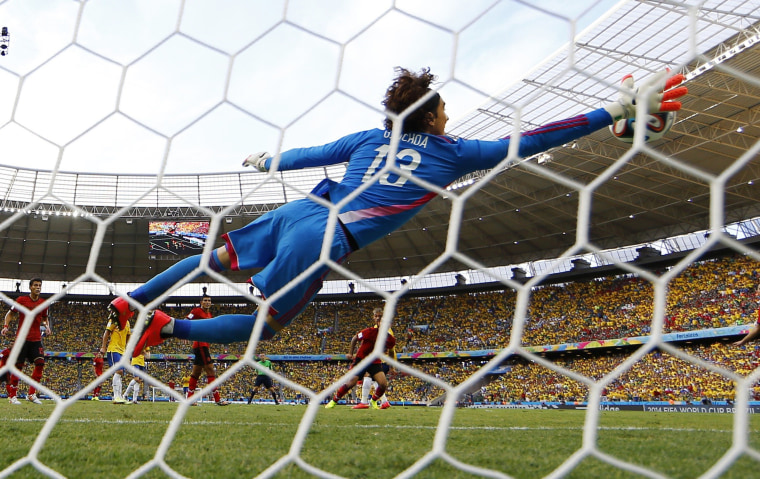 Image: Mexico's goalkeeper Ochoa makes a save on a shot by Brazil's Neymar during their 2014 World Cup Group A soccer match at the Castelao arena in Fortaleza