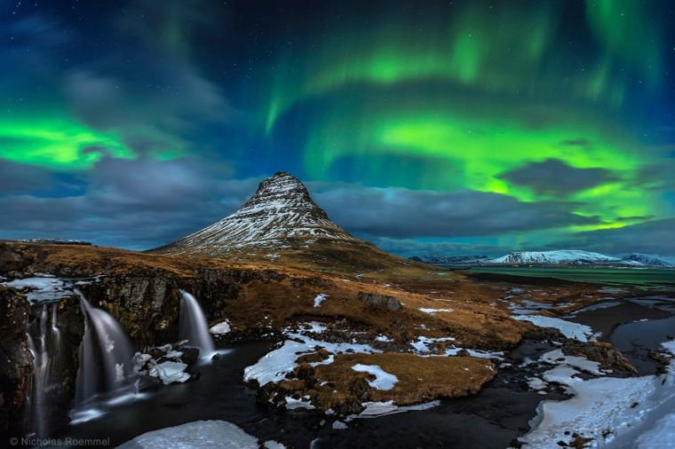 Image: Aurora over Kirkjufell waterfalls in Iceland