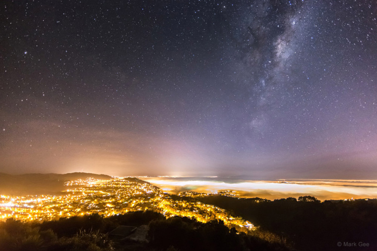 Image:  The Milky Way over the light of Wellington, New Zealand, which is diffused by heavy fog