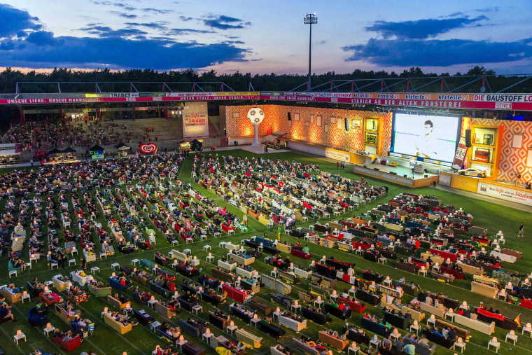 Image: File photo of people watching 2014 World Cup soccer match during public viewing event at Alte Foersterei stadium in Berlin