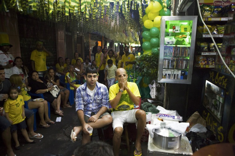 Image: Brazil soccer fans watch a televised screening of a 2014 World Cup Group A soccer match in Rio de Janeiro
