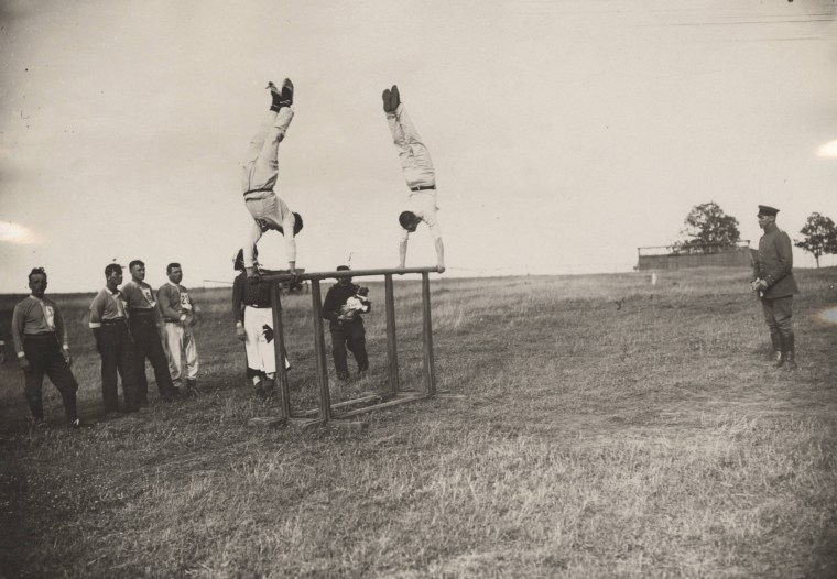 Image: Officers of the Imperial German Air Service compete at a squadron athletics meeting near the Western Front in this 1917 handout picture