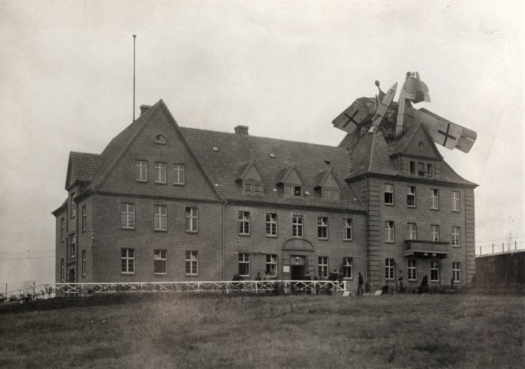 Image: A German Friedrichshafen seaplane is seen crashed into a building in Germany in this handout picture