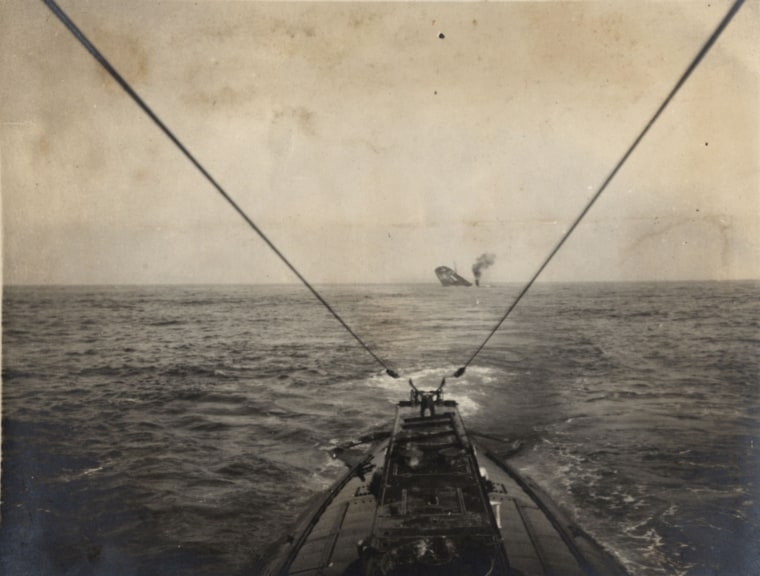 Image: A German U-boat sinks an Allied merchant vessel in the Atlantic Ocean in this 1915 handout picture