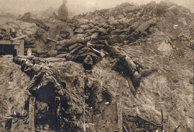 Image: Dead British soldiers are pictured at a machine gun position on the Western Front in this 1918 handout picture