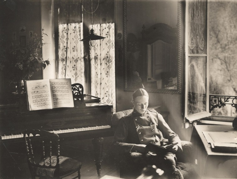 Image: A German officer of Flieger Abteilung 280 reads a book in a chateau where he is stationed near the Western Front