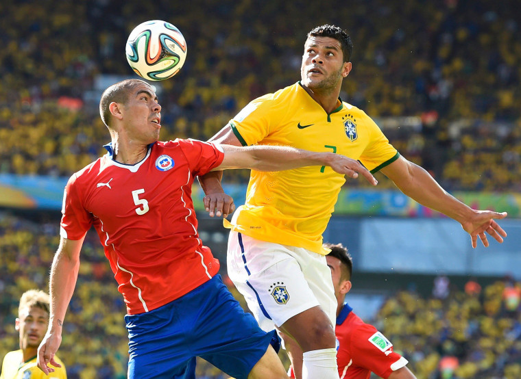 Image: Chile's Silva fights for the ball with Brazil's Hulk during their 2014 World Cup round of 16 game at the Mineirao stadium in Belo Horizonte