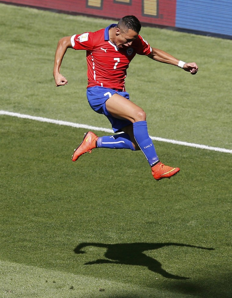 Image: Chile's Sanchez celebrates after scoring a goal against Brazil during their 2014 World Cup round of 16 game at the Mineirao stadium in Belo Horizonte