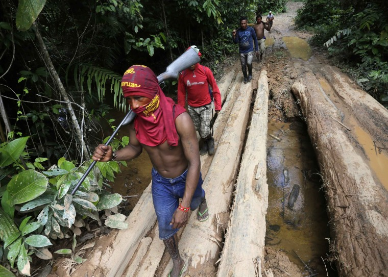 Image: Ka'apor Indian warriors hike during jungle expedition to search for and expel loggers in the Alto Turiacu Indian territory