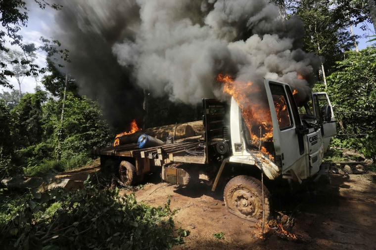 Image: A logging truck burns after it was discovered and set on fire by Ka'apor Indian warriors in the Alto Turiacu Indian territory