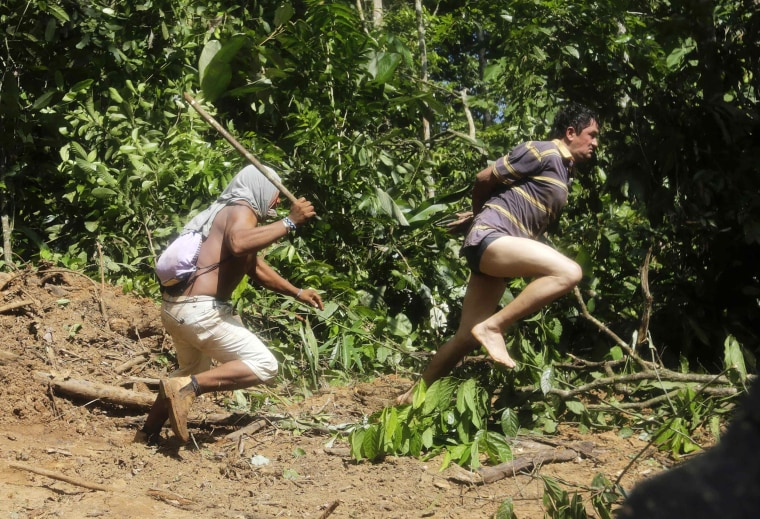Image: A Ka'apor Indian warrior chases a logger who tried to escape in the Alto Turiacu Indian territory