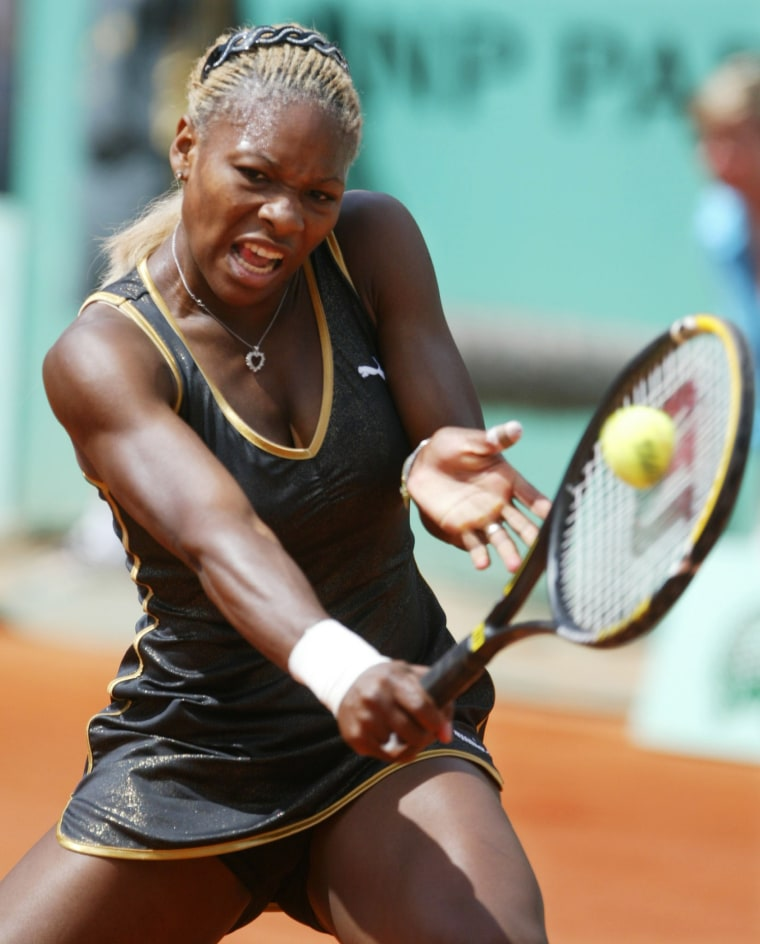 SERENA WILLIAMS OF THE USA RETURNS A BACKHAND AT FRENCH OPEN FINAL.