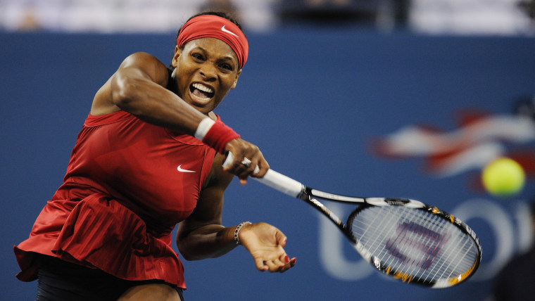 Serena Williams of the US smashes a retu