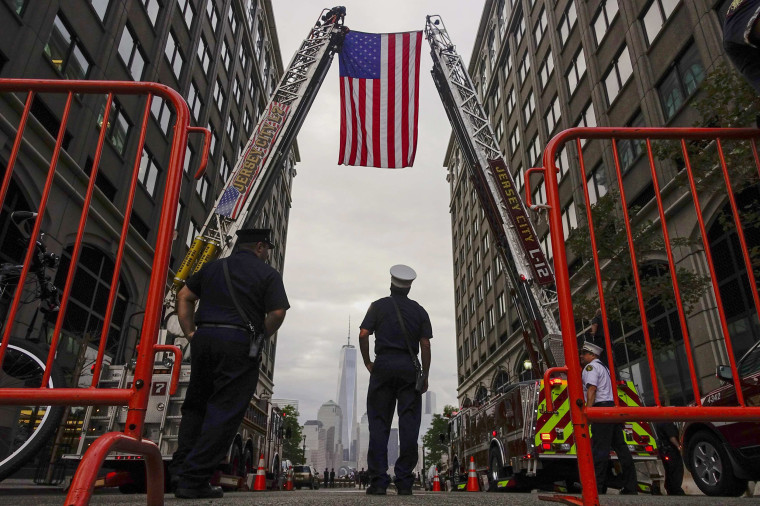 Image: Jersey City firefighters attend a ceremony at the 9/11 memorial during the 13th anniversary of the 9/11 attacks on the World Trade Center, in Exchange Place, New Jersey