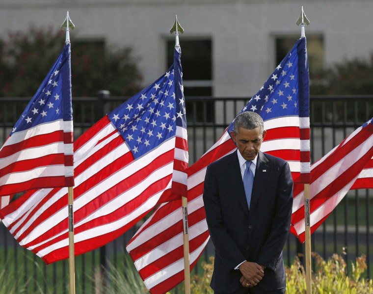 Image: U.S. President Barack Obama pauses during a moment of silence at the Pentagon in remembrance of those who lost their lives in the 9/11 attacks, in Washington