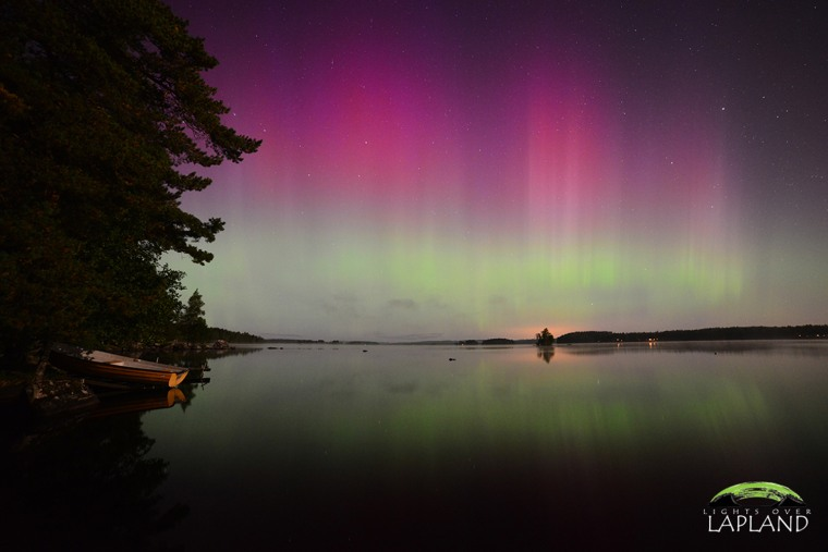 Another great night in Sweden! My wife and I have been in the US visiting family for the last few weeks but we returned to the north just in time for the show! One day after returning to Sweden a massive X - flare released a CME that created amazing auroras in the far southern reaches of Scandinavia. Tonight as I stood on the shore of a mirror calm lake and witnessed one of the brightest pink auroras I have ever seen I was once again reminded of how much I love my Swedish home! Now it is time to head back to Abisko to greet our first guests of the season! Captured with a Nikon D800 and a Samyang 14mm f2.8 lens. Photo: Lights Over Lapland Photographer Chad Blakley