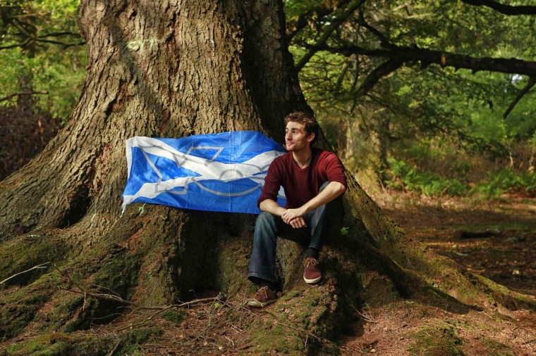 Image: Lewis MacAskill, a university graduate, poses for a photograph in Stornoway on the Isle of Lewis in the Outer Hebrides