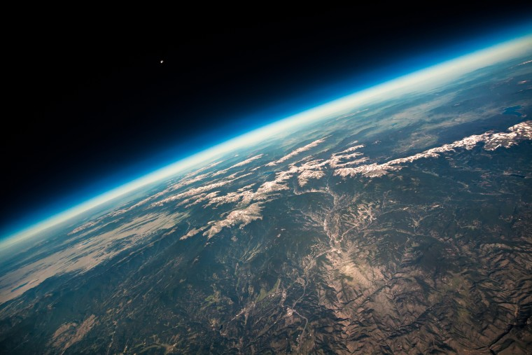 Poised on the brink of space, this astonishing shot shows the curvature of the Earth with the towering Rocky Mountains reduced to tiny wrinkles on the surface below. Taken with the aid of a high altitude balloon, lanuched from Boulder, Colorado, the photographer captures the breath-taking view of the Earth from 87,000 feet about its surface. The tiny dot of the Moon pictured in the distance emphasizes the vast expanase between our plante and its nearest cosmic neighbour.