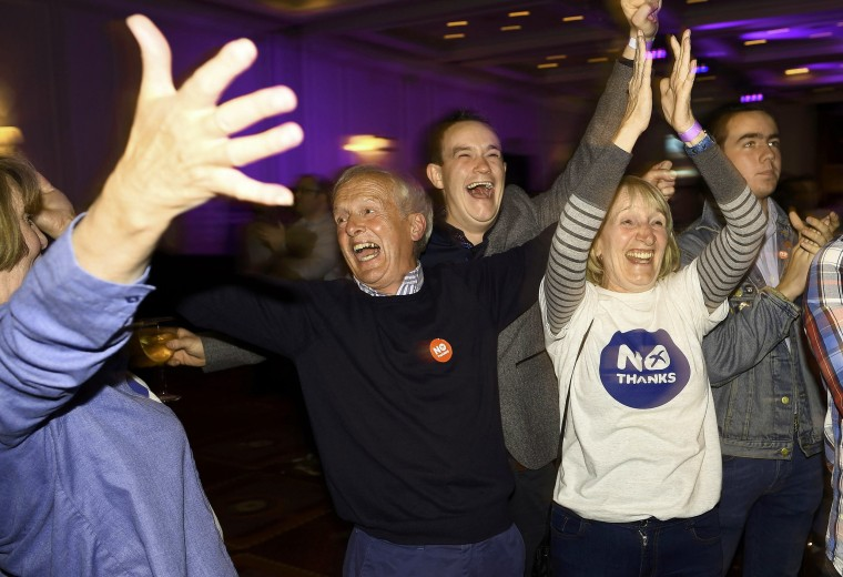 """Image: Supporters from the """"No"""" Campaign react to a declaration in their favour, in Glasgow, Scotland"""